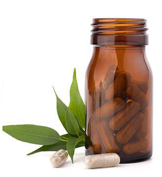 capsule blocca carboidrati fuori e dentro bottiglia marrone di vetro