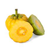 Due frutti gialli con garcinia con steli verdi un frutto tagliato a metà