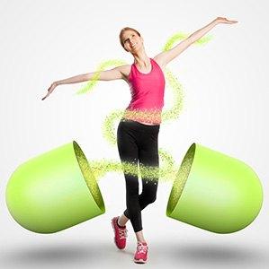 pillola dimagrante aperta e donna in tuta da ginnastica nel mezzo
