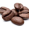 foto di chicchi di caffè che rappresentano caffeina in pillole